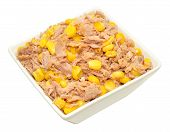 foto of sweet-corn  - Flaked tuna fish and sweet corn mix in a dish isolated on a white background - JPG