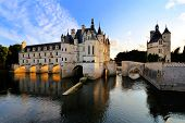 foto of chateau  - Beautiful Chateau de Chenonceau at dusk over the River Cher Loire Valley France - JPG