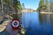 stock photo of compass  - With compass on spring river - JPG