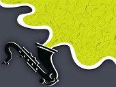 foto of saxophones  - Black saxophone with musical notes on dark grey background - JPG