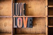 stock photo of rapture  - The word LOVE written in vintage wooden letterpress type in a wooden type drawer - JPG