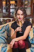 stock photo of champagne glass  - Beautiful young brunette woman drinking champagne - JPG