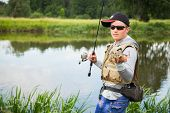 picture of catch fish  - Fisherman holding a large perch - JPG