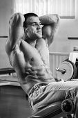 pic of abdominal muscle man  - A man pumping abdominal muscles - JPG