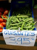 stock photo of green pea  - Ecological fresh green peas pods in a market - JPG