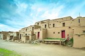 stock photo of pueblo  - Adobe settlement represents the culture of the Pueblo Indians of Arizona and New Mexico USA - JPG