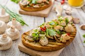foto of sprinkling  - Toast with mushrooms and fried chicken sprinkled with fresh herbs little spicy from garlic and chilli fresh juice - JPG
