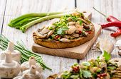 stock photo of sprinkling  - Toast with mushrooms and fried chicken sprinkled with fresh herbs little spicy from garlic and chilli fresh juice - JPG