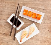 stock photo of sushi  - Sushi maki and shrimp sushi on wooden table background - JPG