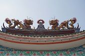 stock photo of fable  - two dragons of Chinese fables on rooftop of the door gate - JPG