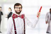 foto of suspenders  - Funny man wearing suspenders pointing up with big pencil - JPG