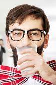 stock photo of suspenders  - Funny man wearing suspenders drinking milk - JPG