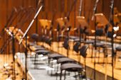 foto of orchestra  - Blurred Orchestra stage with chairs and microhone as Background - JPG