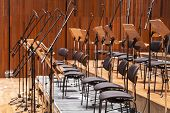 image of orchestra  - Orchestra stage with chairs and microphone Musical Performance