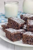 image of brownie  - Sugar powdered homemade brownies with glass of milk - JPG