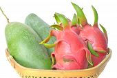 pic of epiphyte  - Mango and dragon fruit in bamboo basket on white background - JPG