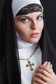 picture of nun  - Front portrait of the young beautiful nun - JPG