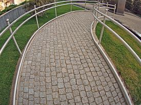 pic of distort  - Ramp for physically challenged from the granite pavement with wide angle fisheye lens and distortion view - JPG