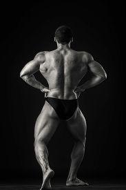 stock photo of strongman  - Strongman on a black background - JPG