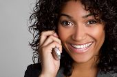 stock photo of young black woman  - Woman on phone - JPG