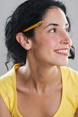 stock photo of close-up  - Young woman wearing pencil behind her ear - JPG