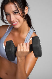 foto of lifting weight  - Smiling fitness woman lifting weights - JPG