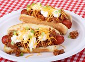 stock photo of hot dogs  - Two chili hot dogs on a paper plate - JPG