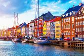 Scenic summer sunset view of Nyhavn pier with color buildings, ships, yachts and other boats in the Old Town of Copenhagen, Denmark t-shirt