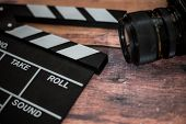 Movie Clapper And Old Camera On A Wooden Background, Movie Shooting, Film, Screenplay, Director poster