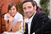 picture of 16 year old  - a 40 years old man and a 16 years old girl with sparkling wine on a restaurant table - JPG