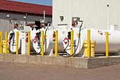 stock photo of gage  - Environmentally safe fuel tanks with safety features such as fire extinguishers and back up pillars to prevent trucks from backing into the tanks - JPG