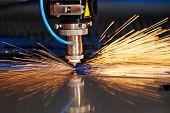 image of cut  - Industrial Laser cutting processing manufacture technology of flat sheet metal steel material with sparks - JPG