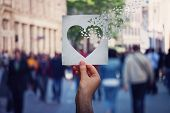 Health And Wellbeing Global Issue As Human Hand Holding A Paper With Heart Symbol Breaking Into Piec poster