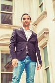 Young Hispanic American Businessman Thinking Outside In New York, Wearing Black Blazer, Blue Jeans,  poster