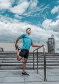 Athlete Guy Doing Knee And Leg Muscle Stretch Before Training. In The Summer In The City, Preparing  poster