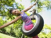 picture of tire swing  - Portrait of girl on tire swing - JPG