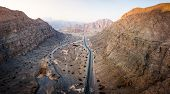 Scenic Desert Road On The Jebel Jais Mountain In The Uae Aerial View poster