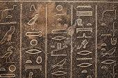 Egyptian hieroglyphs carved in sandstone poster