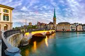 Famous Fraumunster Church And Munsterbrucke Bridge Over River Limmat At Sunset In Old Town Of Zurich poster