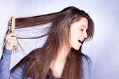 stock photo of fussy  - woman  frustrated with  her hair - JPG