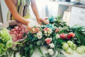 Florist Woman Creating Flower Composition At Home. Worker Composing Wedding Bouquet. Small Business poster