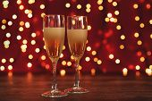 Christmas And New Year Celebration With Champagne. New Year Holiday Decorated Table. Two Champagne G poster