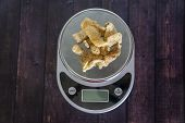 High Fat Low Carb Healthy Snack - Pork Rinds Measured On Kitchen Scale poster