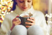 hot drinks, holidays and people concept - close up of beautiful girl in winter sweater with hot choc poster