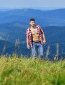 Hiking Concept. Muscular Tourist Walk Mountain Hill. Power Of Nature. Strong Hiker Muscular Torso. A poster