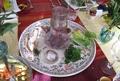 stock photo of seder  - Jewish Holidays: Traditional Seder Plate on Passover Table
