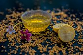 Famous Natural Method For Dandruff On Wooden Surface In A Glass Bowl Consisting Of Fenugreek Seeds P poster