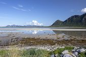 Reflection Of Clouds And Mountains In The Water At Grunnfor On Austvagoy In Northern Lofoten, Norway poster