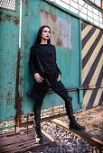 Fashion Shot: Portrait Of The Lovely Rock Girl (informal Model) In Tunic And Leather Pants Standing  poster
