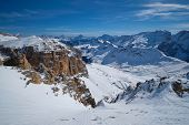 View of a ski resort piste and Dolomites mountains in Italy from Passo Pordoi pass. Arabba, Italy poster